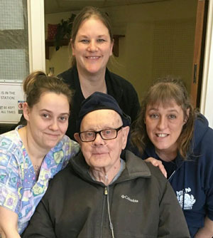 Nursing staff with a resident.